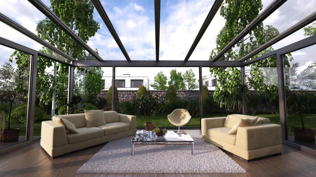 Ogród zimowy stanowi bufor między domem a otoczeniem zewnętrznym.